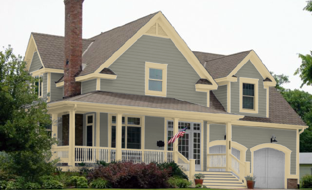 gray-blue siding and cream trim gives a warm feel