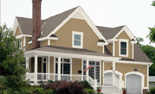 khaki brown siding with white trim gives an earthy look